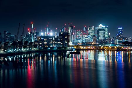 Night View of Part of the Canary Wharf District and Part of the Residential Buildings in the City of London, UK