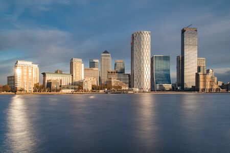 Skyline of Canary Wharf District With the Sun Reflecting in Buildings, London, UK Stock Photo