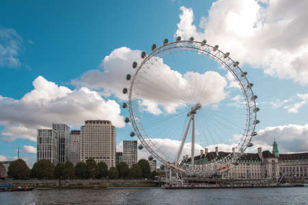 Coca-Cola London Eye observation wheel over Thames river offers high public viewing point of the city