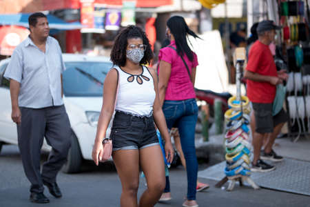 Rio de Janeiro, Brazil - July 3, 2020: Only some people are wearing face masks during the Coronavirus pandemic in suburban area of the city.