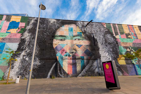 Rio de Janeiro, Brazil - June 30, 2020: Eduardo Kobra's Mural named Native People from the 5 continents. Art on the wall of the Olympic Boulevard.