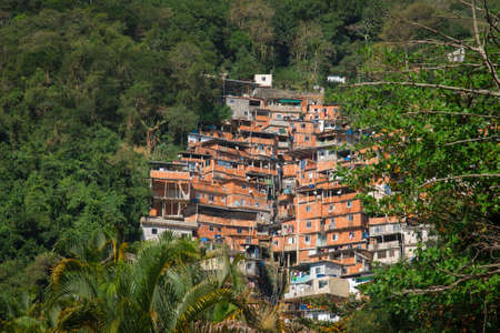 Stacked Red Brick Houses of Brazilian Favela Surrounded by Tropical Forest in Rio de Janeiro, Brazil Фото со стока - 153475758