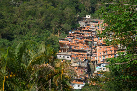 Stacked Red Brick Houses of Brazilian Favela Surrounded by Tropical Forest in Rio de Janeiro, Brazil Фото со стока - 153477936