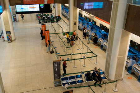 Rio de Janeiro, Brazil - July 16, 2020: Very few travelers at the check in counter at Santos Dumont airport during the Coronavirus pandemic. Фото со стока - 153614782