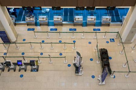 Rio de Janeiro, Brazil - July 16, 2020: Empty check in counter in Santos Dumont airport in Rio de Janeiro city. No travelers during the Coronavirus pandemic. Фото со стока - 153614783