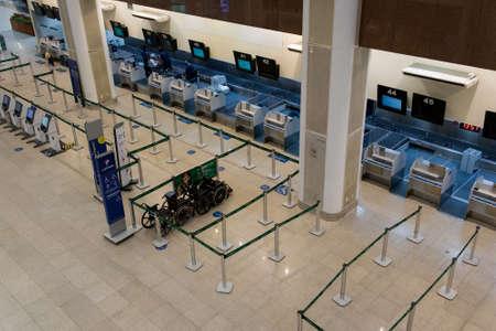 Rio de Janeiro, Brazil - July 16, 2020: Empty check in counter in Santos Dumont airport in Rio de Janeiro city. No travelers during the Coronavirus pandemic.