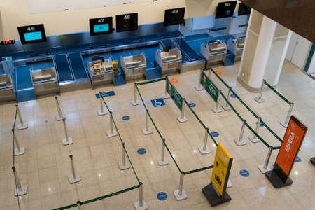 Rio de Janeiro, Brazil - July 16, 2020: Empty check in counter in Santos Dumont airport in Rio de Janeiro city. No travelers during the Coronavirus pandemic. Фото со стока - 153614792