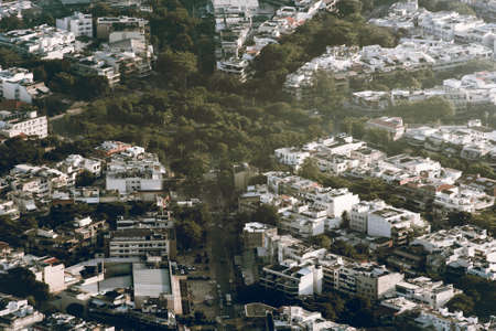 Aerial View of Houses With Streets With Trees Between Them Фото со стока - 154020675