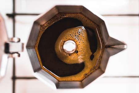 Top View of Coffee in a Moka Pot on the Stove Фото со стока