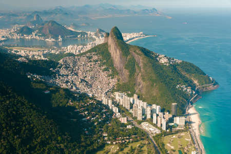 Aerial View of Two Brothers Mountain With Biggest in Brazil Favela Rocinha and Apartment Buildings at Bottom in Front of the Beach in Rio de Janeiro Фото со стока - 154020788