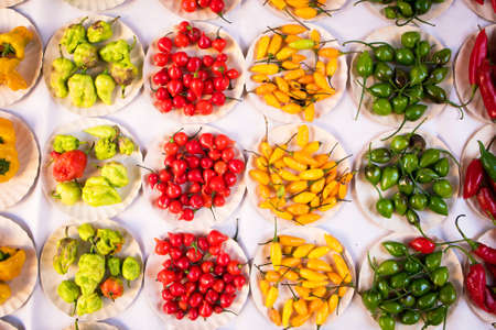 Various Kinds of Pepper in Small Paper Plates at Brazilian Market Фото со стока - 154005681