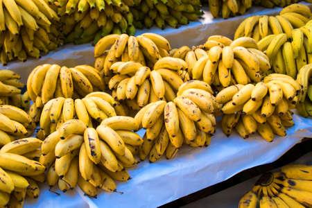 Cluster of Fresh Natural Bananas at the Market Фото со стока - 153991576