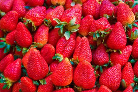 Fresh Juicy Strawberries at the Market Фото со стока - 153853270