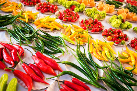Various Kinds of Pepper in Small Paper Plates at Brazilian Market