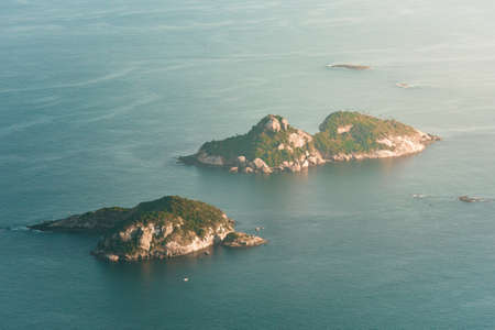 Aerial View of Two Rocky Islands in the Ocean Фото со стока - 154020889