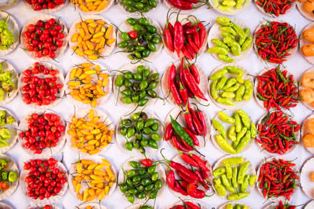 Various Kinds of Pepper in Small Paper Plates at Brazilian Market Фото со стока - 154005711