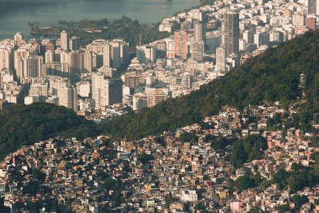 Biggest Brazilian Favela Rocinha on the Hill and Leblon Neighborhood Behind, Contrast Between Rich and Poor, in Rio de Janeiro, Brazil Фото со стока - 154020905