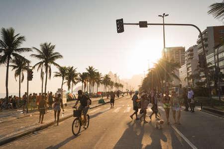 Rio de Janeiro, Brazil - September 13, 2020: Vieira Souto avenue in Ipanema beach with locals enjoying a sunny sunday afternoon.