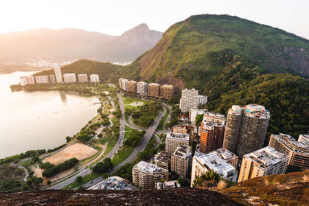 Aerial View of Apartment Buildings in Front of the Lagoon and Between Mountains in Rio de Janeiro, Brazil. Фото со стока - 156064479