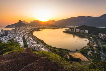 Beautiful Aerial View of Rodrifo de Freitas Lagoon and Ipanema District in Rio de Janeiro by Sunset Фото со стока