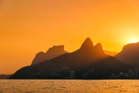 Sun Setting Behind Mountains of Rio de Janeiro Фото со стока