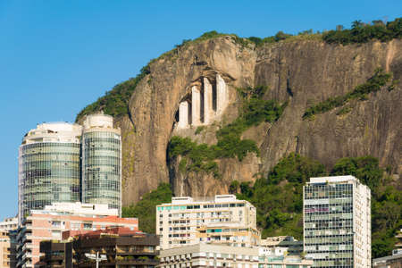 Concrete Support For the Rock on Mountain With Apartment Buildings Below in Rio de Janeiro, Brazil. Фото со стока