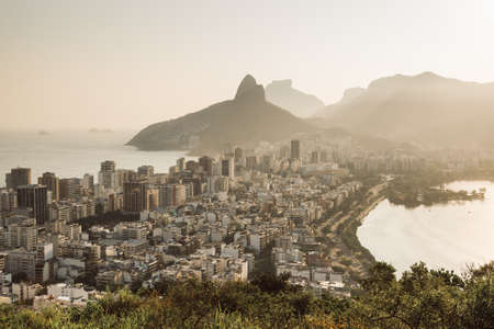 Aerial View of Buildings in Ipanema District and Two Brothers Mountain in the Horizon in Rio de Janeiro, Brazil. Фото со стока
