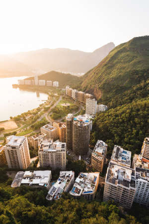 Aerial View of Apartment Buildings in Front of the Lagoon and Between Mountains in Rio de Janeiro, Brazil. Фото со стока