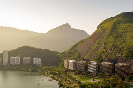 Beautiful View of Mountains and Residential Buildings in Front of the Lagoon in Rio de Janeiro, Brazil. Фото со стока - 156064562