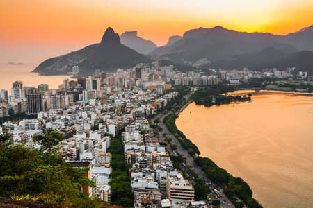 View of Ipanema and Leblon District Buildings and Mountains by Sunset in Rio de Janeiro, Brazil.