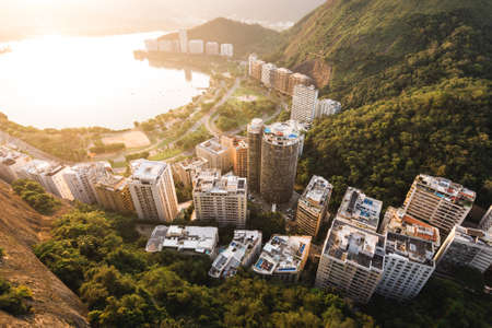 Aerial View of Apartment Buildings in Front of the Lagoon and Between Mountains in Rio de Janeiro, Brazil. Фото со стока - 156064636
