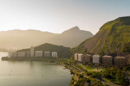 Beautiful View of Mountains and Residential Buildings in Front of the Lagoon in Rio de Janeiro, Brazil. Фото со стока - 156064642