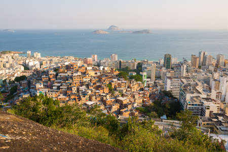 Elevated View of Slums on the Hill and Ipanema District Below With an Ocean in the Horizon in Rio de Janeiro, Brazil. Фото со стока - 156064649