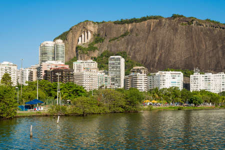 View of Mountains and Residential Buildings Around Rodrigo de Freitas Lagoon in Rio de Janeiro, Brazil. Фото со стока - 156054244