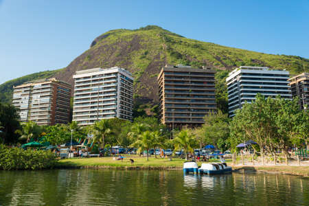 View of Mountains and Residential Buildings Around Rodrigo de Freitas Lagoon in Rio de Janeiro, Brazil. Фото со стока - 156054246