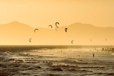 Kitesurfing Activity at Barra da Tijuca Beach on Sunset in Rio de Janeiro, Brazil Фото со стока