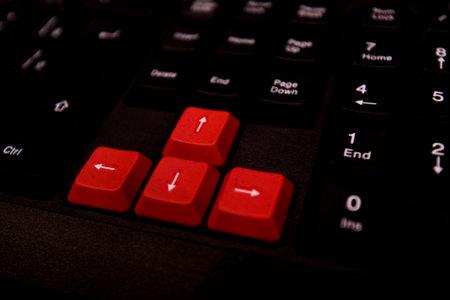 Black Gaming Keyboard With Red Arrow Keys