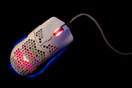 White Gaming Mouse With Led Lights on Black Background Фото со стока