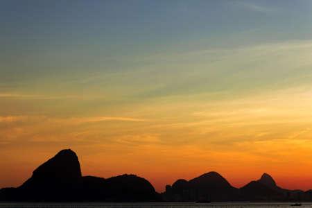 Beautiful Rio de Janeiro Mountain Silhouette View With Sunset Sky Фото со стока