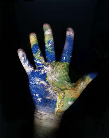 safe water: world texture on open human hand Stock Photo