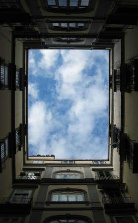 prespective: perfect sky through typical buildings Stock Photo