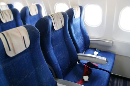 seat rows in an airplane cabin photo
