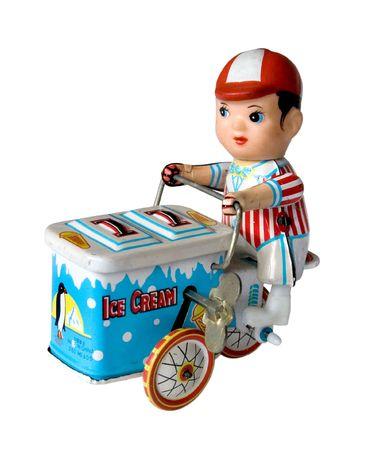 three wheeler: vintage metal toy boy on a three wheeler