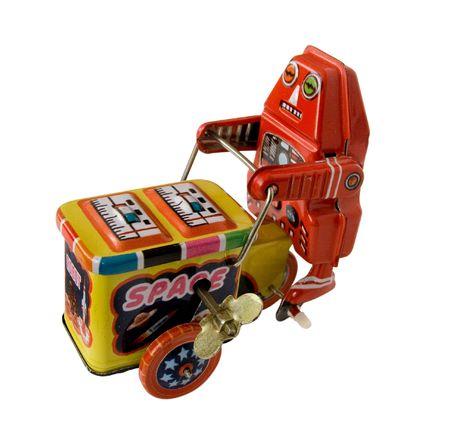 three wheeler: vintage metal robot toy on a three wheeler