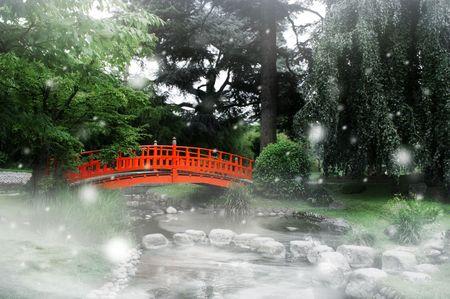 old bridge: Red bridge under snow in a japanese garden Stock Photo