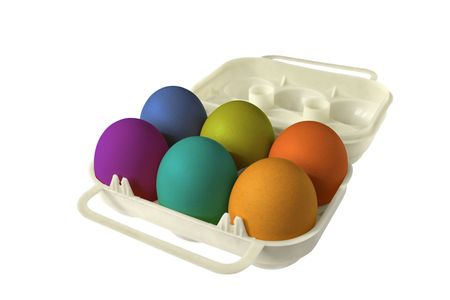 six colored easter eggs in an eggbox photo
