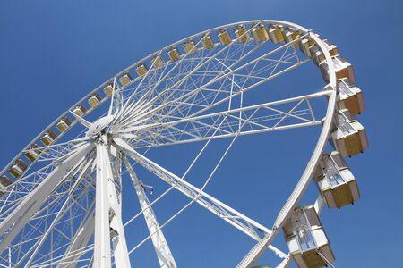 Ferris wheel in an amusement park against blue sky Stock Photo - 7402506