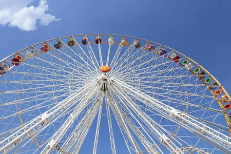 Ferris wheel in an amusement park against blue sky Stock Photo - 7402354