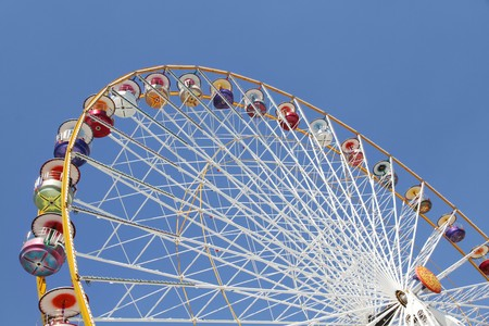 Ferris wheel in an amusement park against blue sky Stock Photo - 7402505