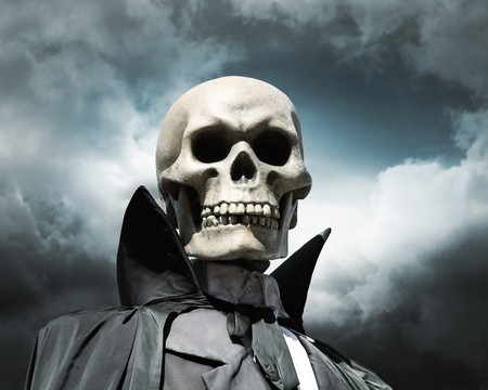 horrors: grim reaper. deaths skeleton on a cloudy dramatic sky